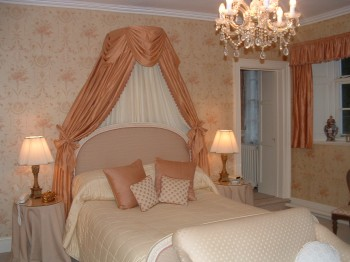 The Master Bedroom should be feminine enough to feel soft, yet not so feminine as to make the man of the house uncomfortable.