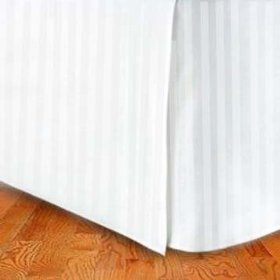 A white striped Eqyptian cotton bedskirt that is properly fitted