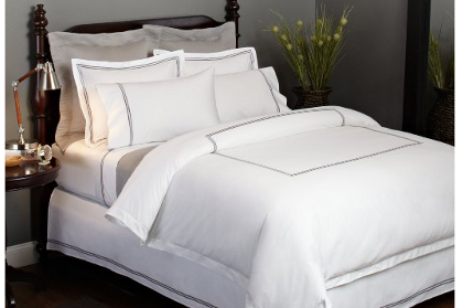 grey and white hotel bedding
