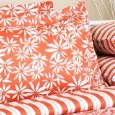 Mellow orange in floral print with stripes for a summer in the tropics